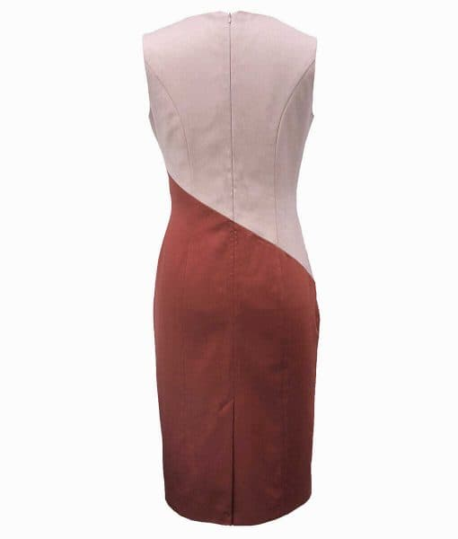Back view of a beige and burnt orange princess line dress with a seam running diagonally from the hip to waist.