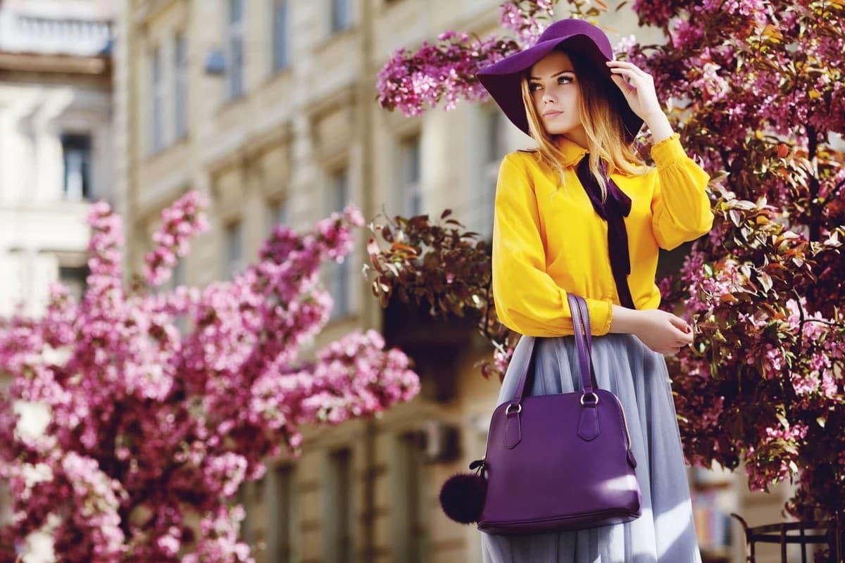 Outdoor portrait of trendy young girl posing in street