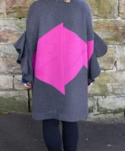 Rear view of grey and pink flutter sleeve poncho