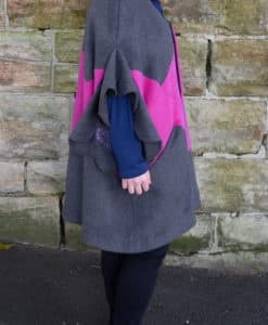 Side view of grey and pink flutter sleeve poncho