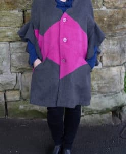 Front image of grey and pink flutter sleeve poncho